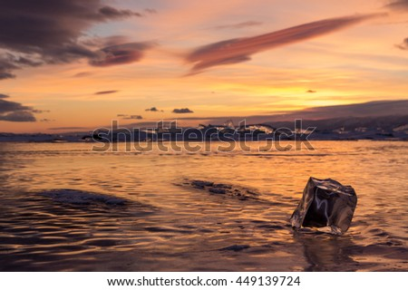Sunset in the icy Lake Baikal, Irkutsk region, Russia. - stock photo