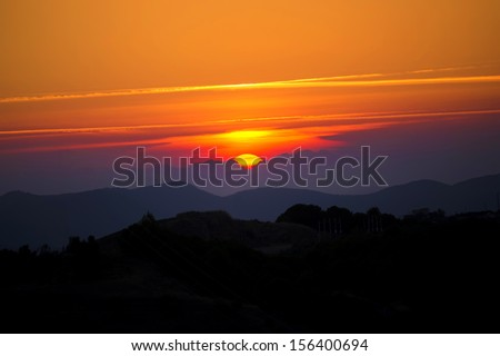 Sunset in the mountains. - stock photo