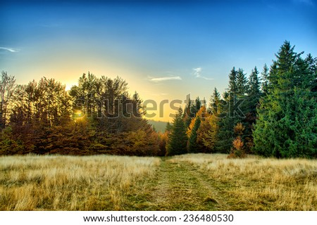 Sunset in the mountains - stock photo