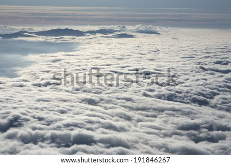 Sunset in the mountains above the clouds