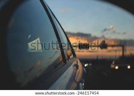 sunset in the rerview mirror - stock photo