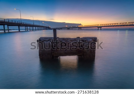 sunset in the sea and transport bridge