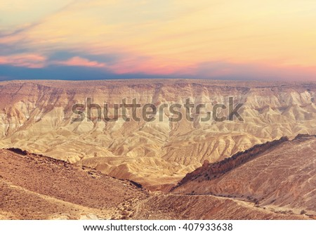 Sunset in the stone desert. Stone desert landscape. Geological erosion land form Negev, National geological park HaMakhtesh HaGadol. Israel .Toned coloros Vintahe style photo - stock photo