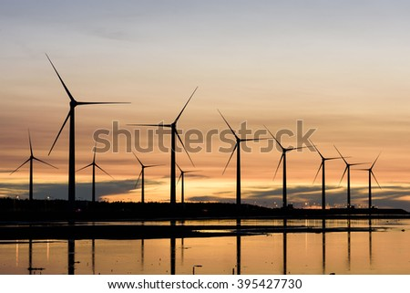 sunset in the windmills and coast in Taichung, Taiwan - stock photo
