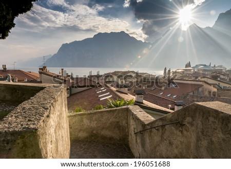 Sunset in Torbole village at Lake Garda (Italy) - stock photo