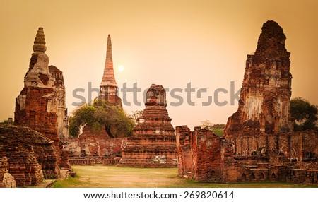 Sunset in Wat Mahathat. Ayutthaya historical park. Panorama - stock photo