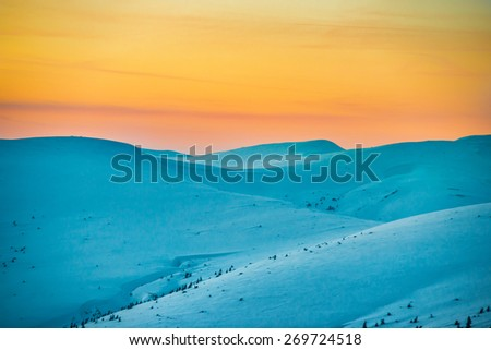 Sunset in winter mountains covered with snow