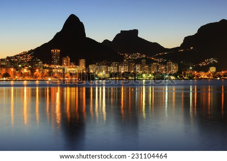 Sunset Lagoon Rodrigo de Freitas (Lagoa), mountain Two brothers, Stone of Gavea, Rio de Janeiro, Brazil - stock photo
