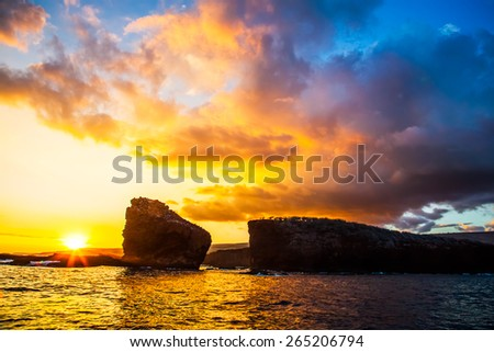 Sunset.  Lanai, Hawaii. Sweetheart rock.  Puu Pehe. Two Rocks. - stock photo