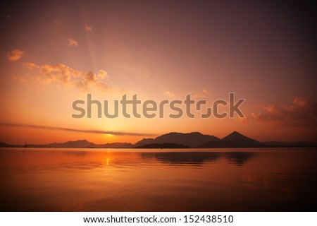 Sunset landscape at lake and mountain in Sri Lanka - stock photo