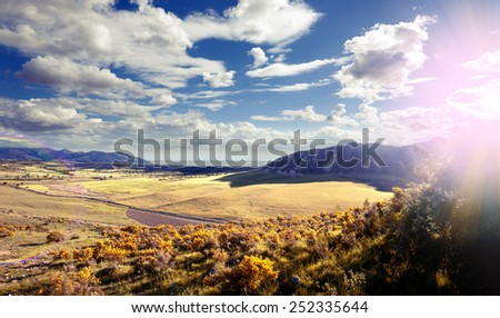 Sunset landscape.Fields and sun. Blue sky and clouds dream scape - stock photo
