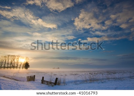 sunset landscape in winter with snow in Holland - stock photo