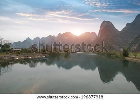 Sunset landscape of bama in guangxi,china - stock photo