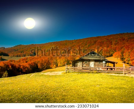 Sunset landscape with old rural house in the Carpathian mountains. Ukraine, Europe - stock photo