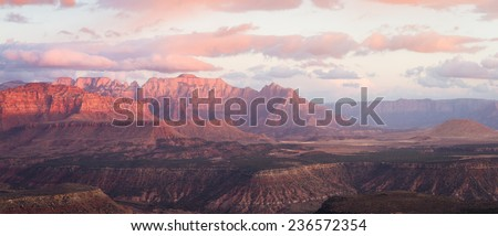 sunset landscape with the red sandstone mountains of Zion National Park in Utah and lower cloud cover with dynamic colors
