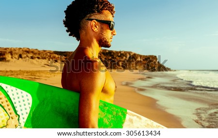 Sunset light, beach, freedom, Surfer with board - stock photo