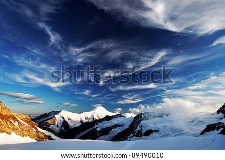 Sunset light in Berner Oberland, Switzerland - UNESCO Heritage - stock photo