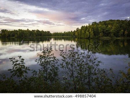 Sunset light on Big Arbor Vitae Lake in the North Woods of Wisconsin.