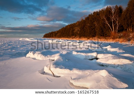 Sunset light on the winter shoreline of Peninsula State Park in Door County, Wisconsin.  - stock photo