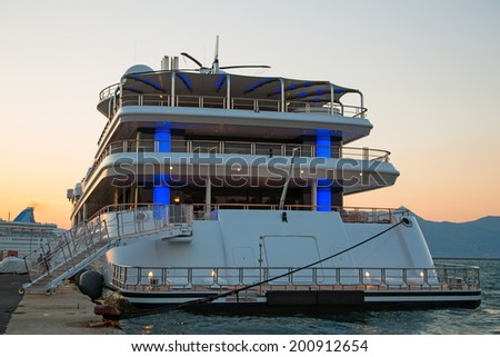 Sunset: Luxury large super or mega motor yacht in the evening.  - stock photo