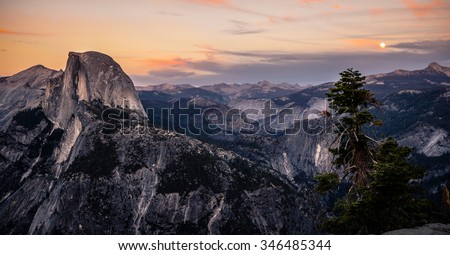 Sunset & Moonrise on Half Dome, Yosemite National Park, California  - stock photo