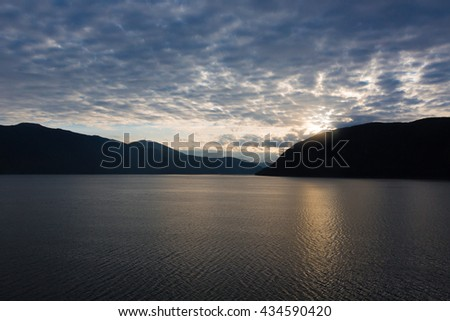 Sunset mountain seaside Geiranger, Norway fjord, - stock photo