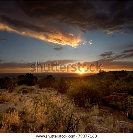 Sunset near Albuquerque, from the base of the Sandia Mountains - stock photo