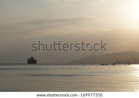 Sunset near Red sea, against sunbeams - stock photo