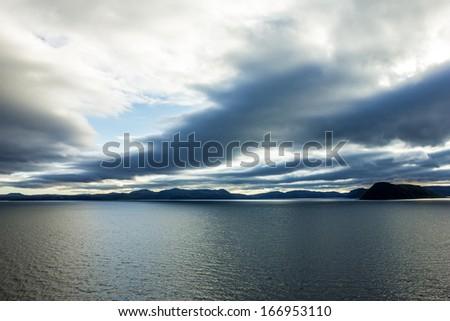 Sunset - Norway fjords  seascape - stock photo