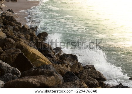 sunset ocean surf on the coast. - stock photo