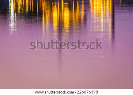 sunset of city on the park with reflections water silhouette - stock photo