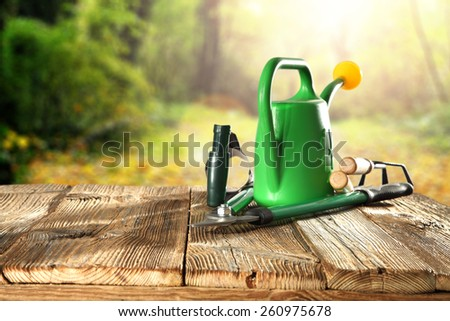sunset of sun in garden of spring and garden tools  - stock photo