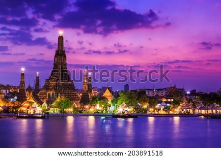 Sunset old temple riverside chao phraya river wat arun temple in bangkok asia Thailand  - stock photo