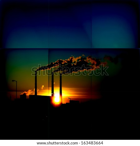 Sunset on a background of smoking chimneys - stock photo