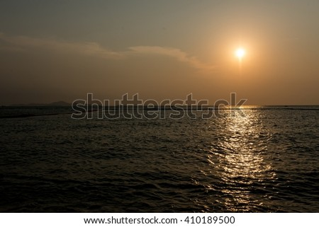 Sunset on a beach in a tropical country