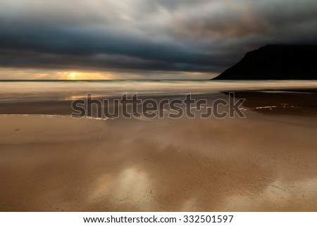 Sunset on a beach in the Arctic Ocean