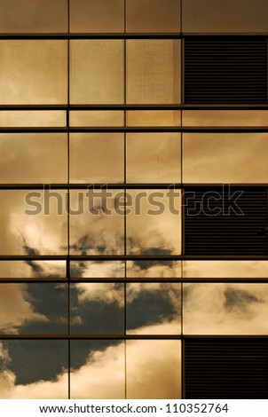 Sunset On a Building Window Wall - stock photo