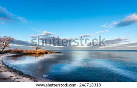 Sunset on a Chesapeake Bay beach in Maryland - stock photo