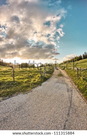 Sunset on a country lane - stock photo