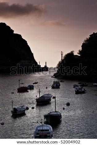 Sunset on a fishermen's village. - stock photo