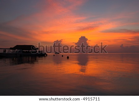 Sunset on a jetty in the Togian Islands (Indonesia).