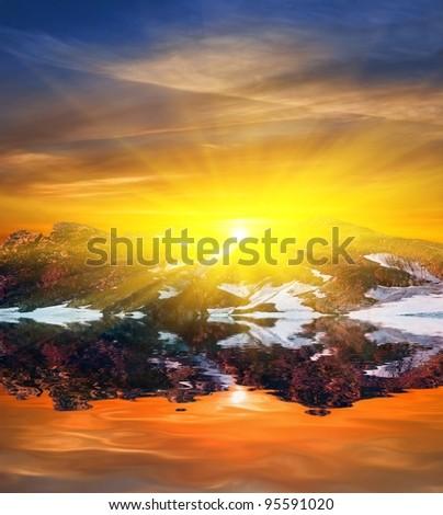 sunset on a mountain lake - stock photo