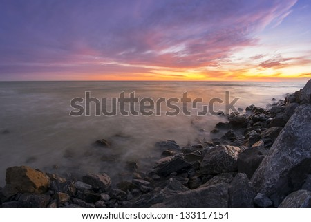 Sunset on a rocky coast