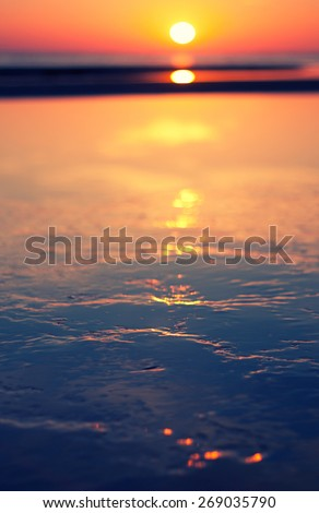 sunset on a sea beach - stock photo