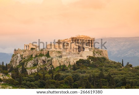 sunset on Acropolis hill with Parthenon - the temple of Athena Pallas goddess of wisdom, Athens, Greece, gradient warm filter were applied - stock photo