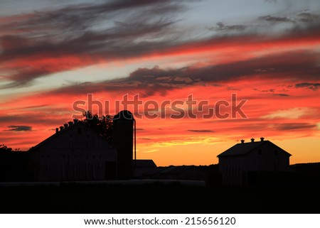 Sunset on an Amish farm in Lancaster County, Pennsylvania, USA. - stock photo