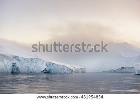sunset on arctic ocean at Ilulissat ice fjord, Greenland. - stock photo