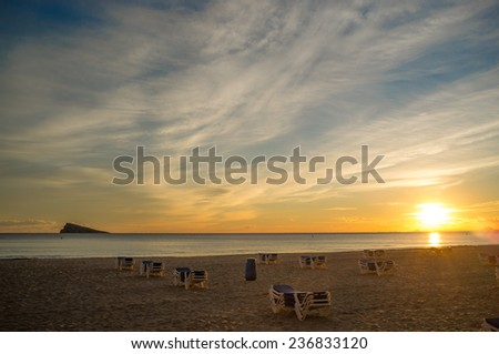Sunset on Benidorm beach with its island in the background - stock photo