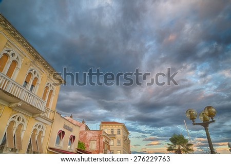 Sunset on buildings of the harbour of Porec  in Croatia