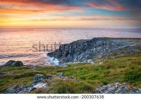 Sunset on cliffs at West Pentire above Crantock near Newquay in Cornwall - stock photo